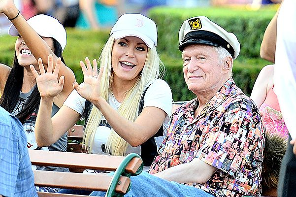 EXCLUSIVE: Hugh Hefner and wife Crystal Hefner ride Toy Story Mania and watch the parade at Disneyland