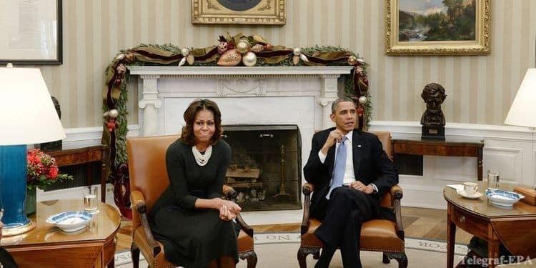 Obama-s-zhenoy_EPA